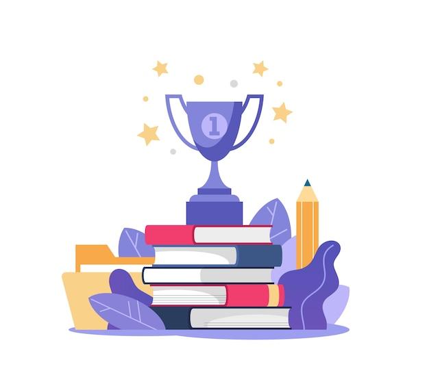 위에 책과 우승자 컵의 스택
