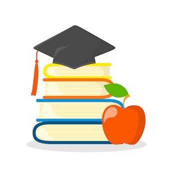 上の卒業の帽子が付いている本のスタック。知識と教育のアイデア。図