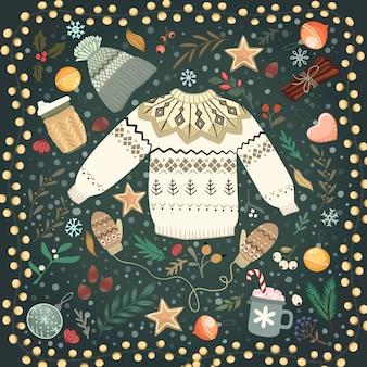 Стек уютный трикотажный свитер и фонарь на столе