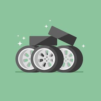 Стопку новых автомобильных шин и колес на зеленом фоне