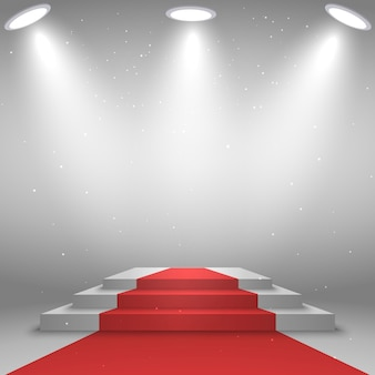 Stage for awards ceremony. white podium with red carpet, illuminated by spotlight Premium Vector