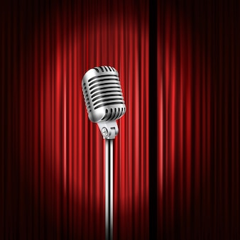 輝くマイクのイラストが描かれたステージカーテン。スタンダップコメディショーのコンセプト