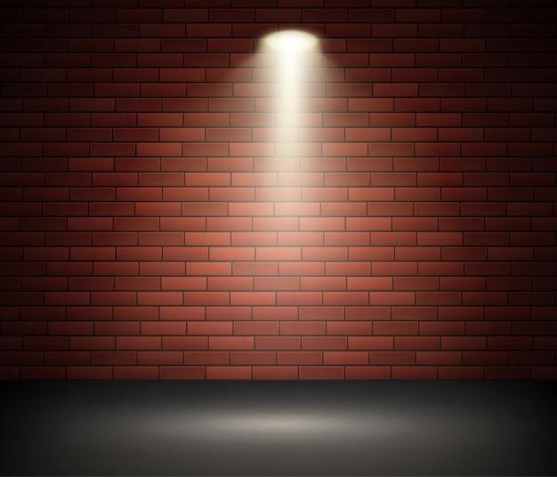 벽돌 벽에 스포트 라이트로 조명 무대