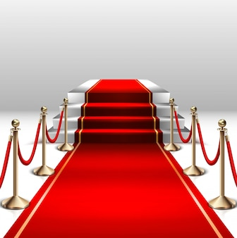 Stage with red carpet and gold barrier.