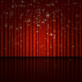 赤いカーテンとストリーマ効果のあるステージ。