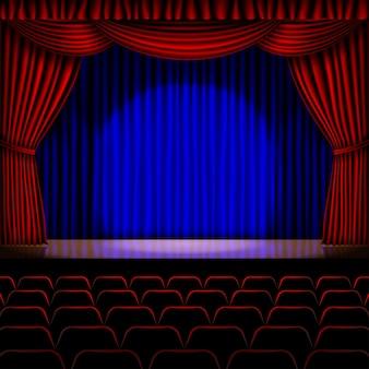 背景に赤いカーテン付きステージ