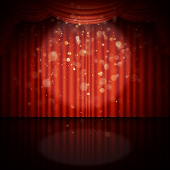 Stage with red curtain.