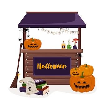 ランタンカボチャの本と魔女のアイテムのお祝いの装飾が施された秋のハロウィーンの休日のための屋台カウンター...
