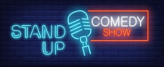 Stand up Comedy show neon sign. Blue microphone on brick wall.