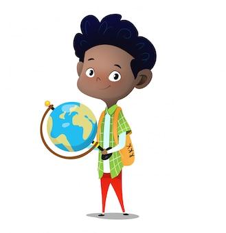 Standing boy holds big desktop terrestrial globe in hands