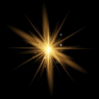 キラキラとスターバースト。黄色の輝く光のセットが黒い背景に爆発する魔法の粉塵粒子。ゴールドラメブライトスター。