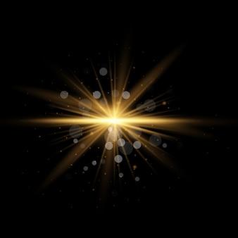 キラキラとスターバースト。黄色の輝く光のセットが透明な背景に爆発します。ゴールドラメブライトスター。透明な太陽、明るいフラッシュ