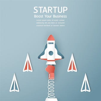 Start up concept in paper cut, craft and origami style. rocket is flying on blue sky.