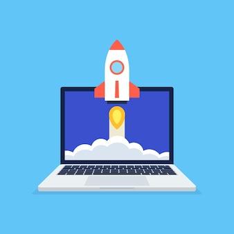 파란색 배경에 노트북 화면에서 빨간색 로켓 발사와 시작 비즈니스 프로젝트 개념