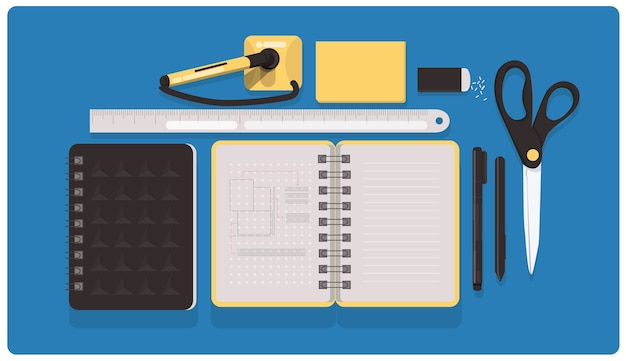 Stationary flatlay blue yellow and dark grey