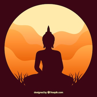 Statue of buddha silhouette with sunset