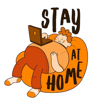 Stay at home. man lying on a pouf using the computer