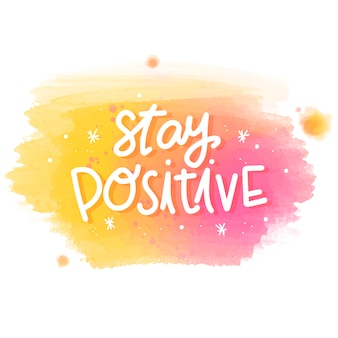Stay positive message on watercolor stain