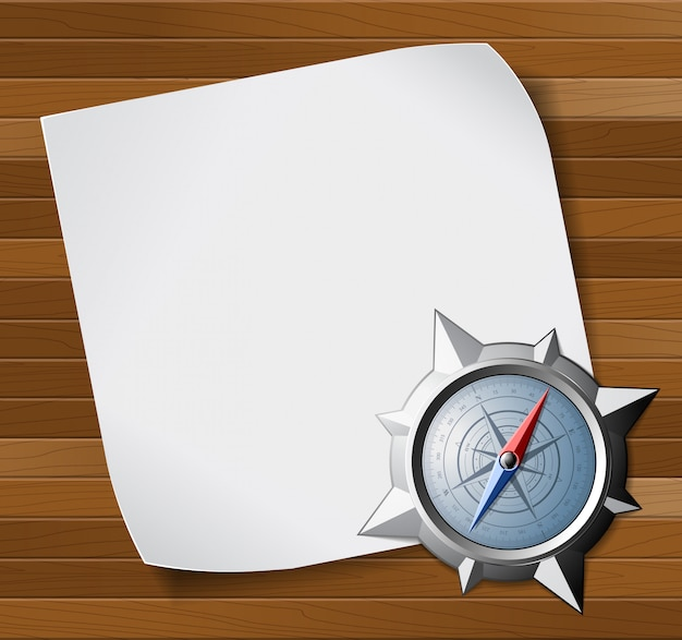 Steel compass and white paper over wooden background
