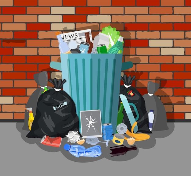 쓰레기로 가득 찬 강철 쓰레기통