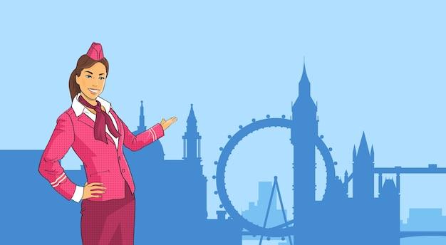 Stewardess in uniform open palm to london city view