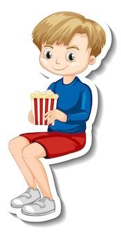 ポップコーンを座って食べる男の子のキャラクターのステッカーデザイン