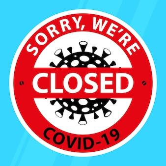 문, 바닥에 스티커, '폐쇄 죄송합니다, covid-19'라는 문구가 있습니다.