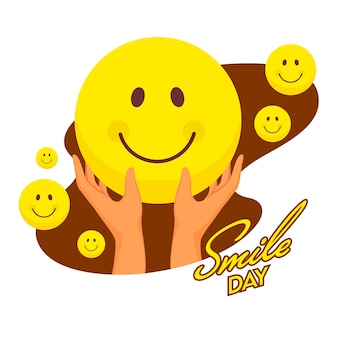 Sticker style smile day text with hand holding smiley emoji on brown and white background.