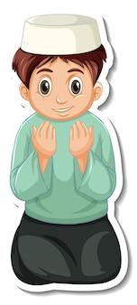 Un modello di adesivo con un ragazzo musulmano che prega