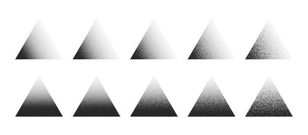 白い背景の上のさまざまなバリエーションで設定された点描三角形手描きドットワーク抽象的な形
