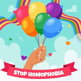 Stop homophobia with hand holding rainbow balloons