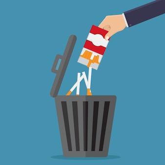 喫煙をやめ、タバコをゴミ箱に捨てる
