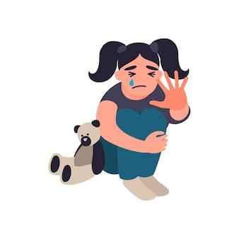 폭력과 학대받는 아이들을 멈추십시오 어린 소녀가 바닥에 앉아서 울고 있습니다