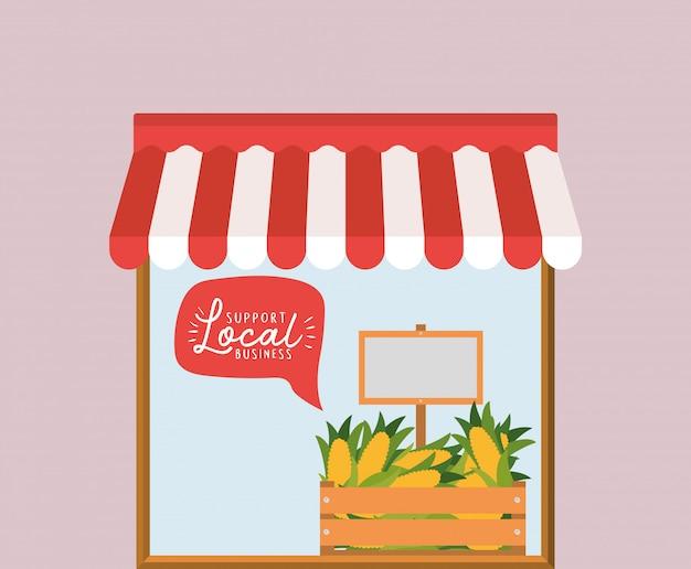 トウモロコシを箱の中に入れて、バブルの中で地元のビジネスをサポートする