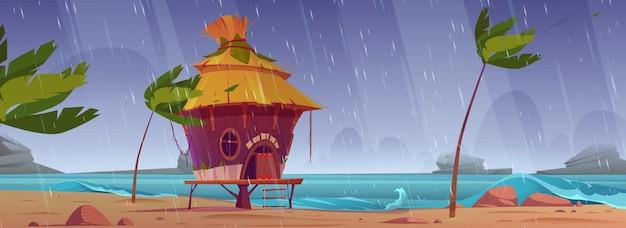 雨の下で小屋やバンガローのあるビーチで嵐