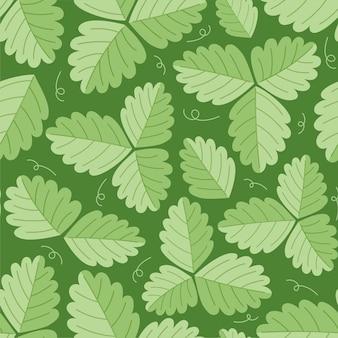 Бесшовный узор из листьев клубники. зеленые листья на зеленом фоне. векторная иллюстрация.
