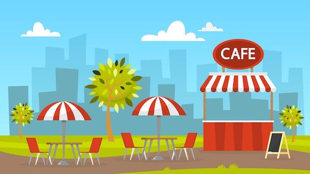 Уличное кафе. кафетерий под открытым небом. городской пейзаж на фоне