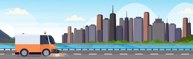 ストリートスイーパートラックマシンクリーニングプロセス産業車両都市ロードサービスコンセプトモダンな街並み背景水平バナーフラット