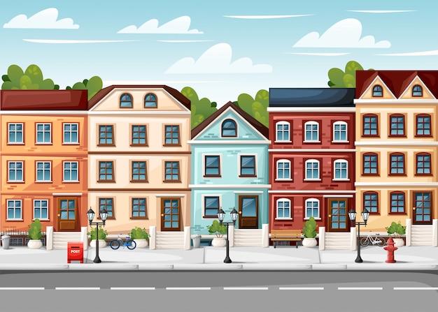 Улица с разноцветными домами, огни пожарного гидранта, скамейка, красный почтовый ящик и кусты в вазах, страница веб-сайта и мобильное приложение в мультяшном стиле