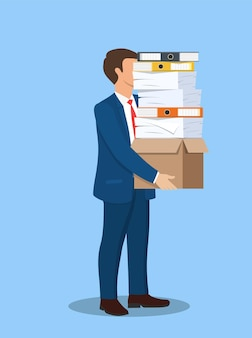 Stressed businessman holds pile of office folders