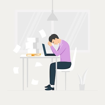 Stressed young male employee at workplace