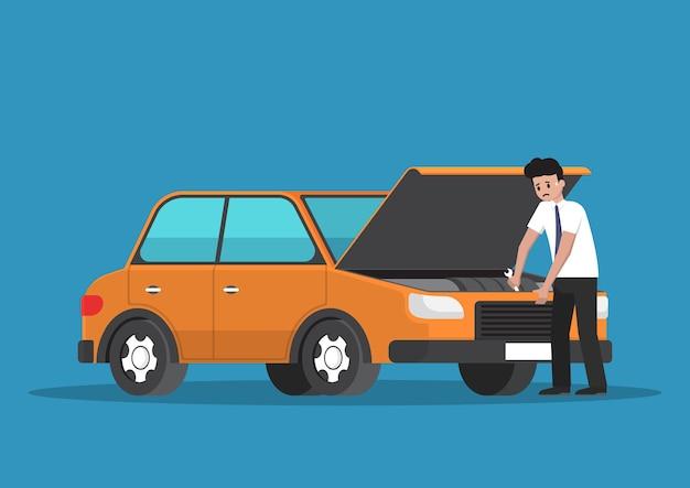 ストレスの多いビジネスマンが自分で車を修理します。