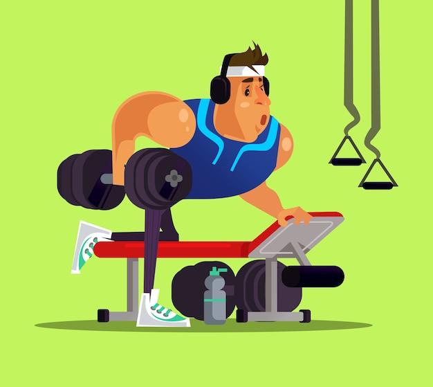 Сильный большой спортивный человек делает тренировку в тренажерном зале. здоровый образ жизни