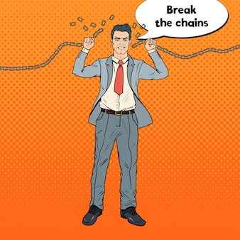 Strong businessman breaks the chains