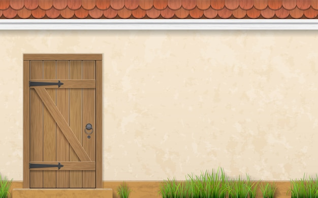 Stucco wall of a house with an old wooden door.