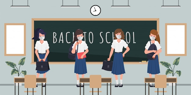 Student back to school with new normal concept. classroom blackboard background.
