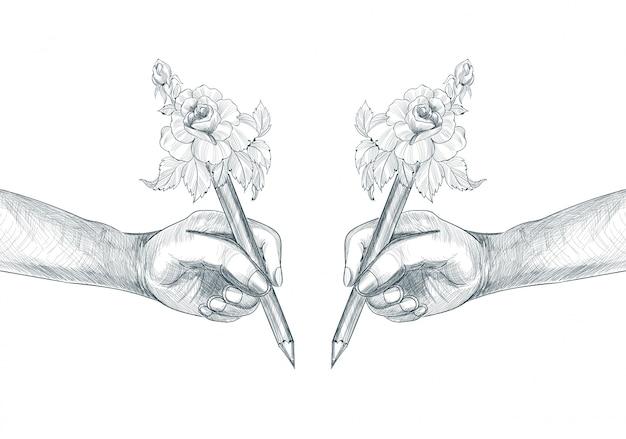 鉛筆スケッチを持っている学生の手