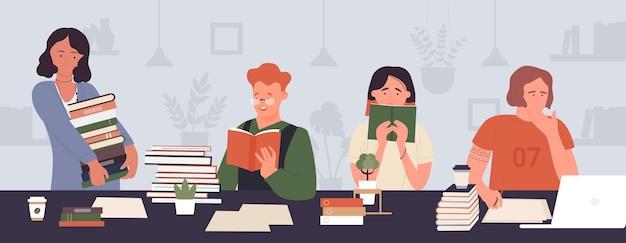학생 사람들은 테이블에 앉아 책을 읽고 함께 읽고 공부합니다.