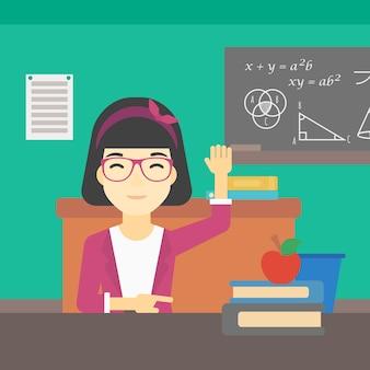 대답을 위해 수업 시간에 손을 올리는 학생.