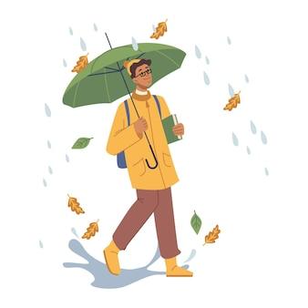 Студент, идущий под дождем, держа зонтик